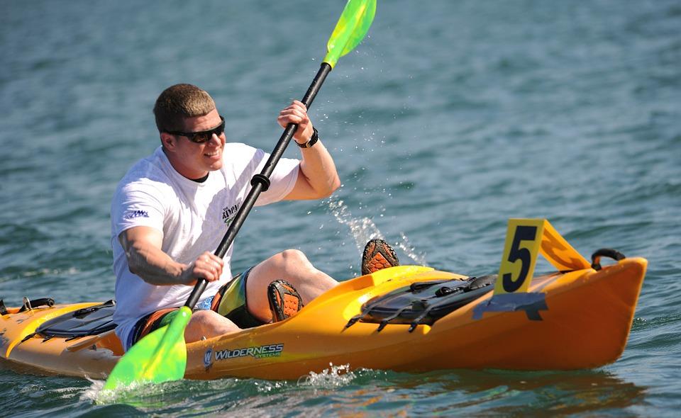 Man paddling in a sit on top kayak
